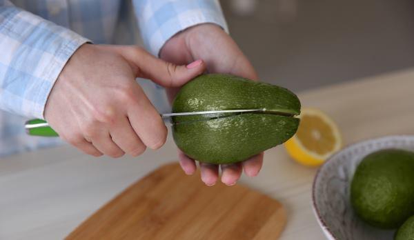 cutting fresh avocado